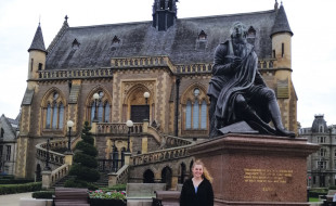 Emily Tyrrell in front of a statue of Robert Burns.